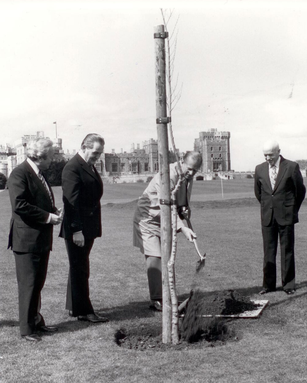 Prince Phillip planting an Elm tree.